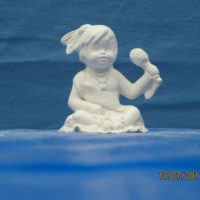 "kimple 2709 jan indian calendar kid  5.1/2""H   bisqueware"