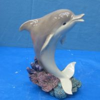 """gare 2918 dolphin on coral (FIS 5)  10""""H  bisqueware"""