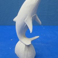 dolphin on rock   bisqueware