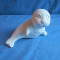 "gare 2341 seal pup sitting (FR 89)  7""L  bisqueware"