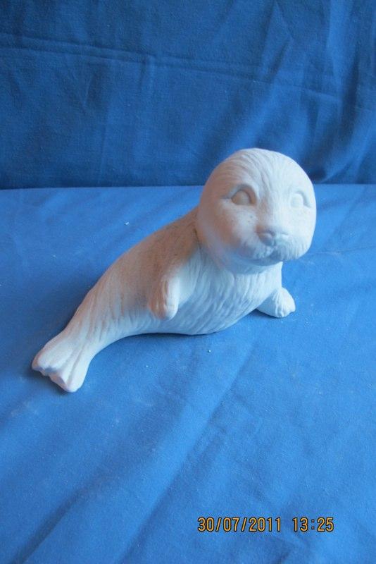 "gare 2341 seal pup sitting (FR 89)  7""L  bisqueware"