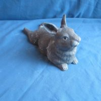 "duncan 1773 baby rabbit lying legs out back(RB 14)  4.75""H,9.5""L  bisqueware"