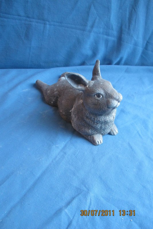 """duncan 1773 baby rabbit lying legs out back(RB 14)  4.75""""H,9.5""""L  bisqueware"""