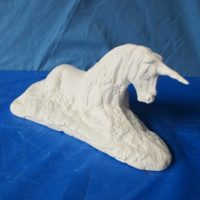 "Doc holiday 1190 Large unicorn on base (HR 71) 14""L  bisqueware"